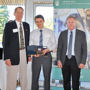 Tremayne Koochin (M), winner of Head of Interdisciplinary Studies Award and R.W. Schutz Faculty Prize in Kinesiology Head of the May 2017 Graduating Class Award, presented by the Director of the School of Kinesiology, Dr. Robert Boushel (R) and Bob Schutz (L), Professor Emeritus, School of Kinesiology.