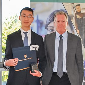Michael Wu, Winner of CSEP Undergraduate Student Award and Head of Kinesiology & Health Sciences Award, presented by the Director of the School of Kinesiology, Dr. Robert Boushel.