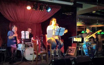 Kristina Sheldon performs with Digger Dan and the Dirt Brigade.