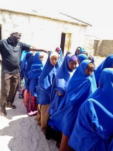 Jama Ahmed Mohamed with female students from the Kudhaa Primary School in Khudhaa, Somalia.